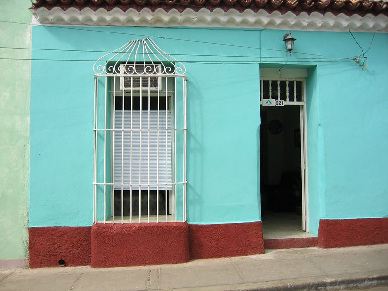 Turquoise and red house front in Trinidad, Cuba