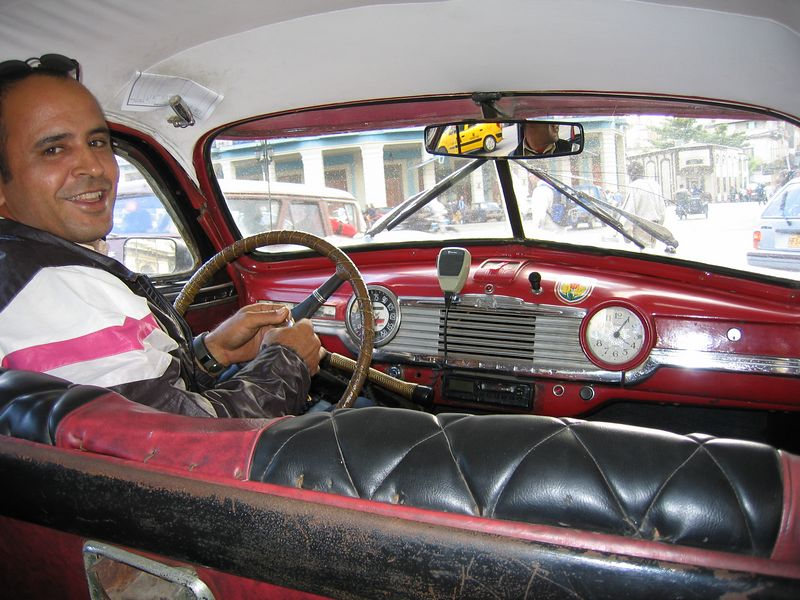 Taxi driver in old fashioned car in Havana Cuba