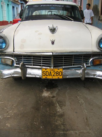 Old fashioned car and license plate in Trinidad, Cuba