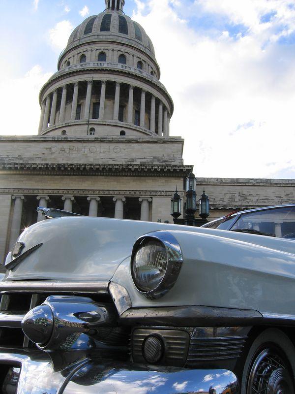 El Capitolio building and old car in Havana Cuba