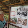 The local Cuban archaeologist describing the excavations.  She is included in the picture on the wall of the initial excavations.