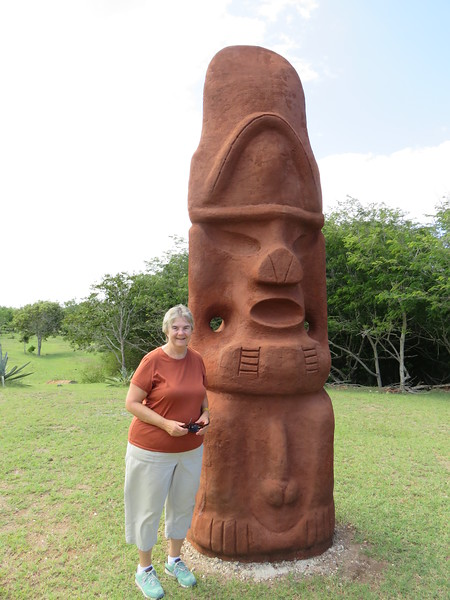 Susan by one of the reconstructed Taino monuments in the first encounter monument.