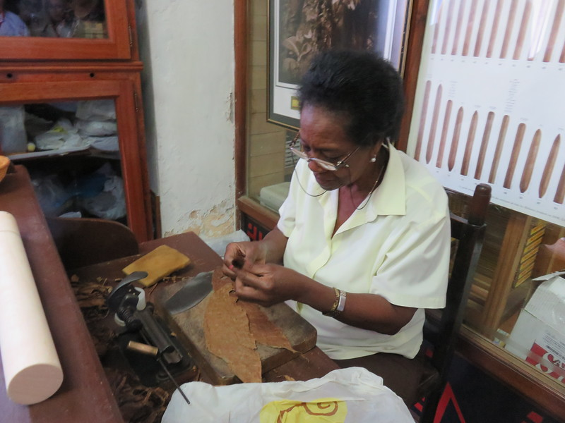 Hand wrapping cigars at the Old Havana craft market.