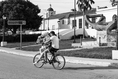 Young couple on bike, riding a bicycle in Regla, Havana, Cuba