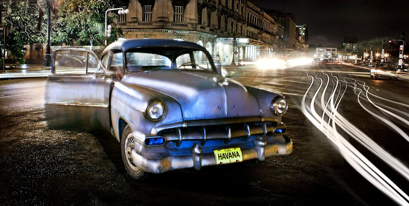 Old American Car at Old Havana, Cuba. Timed exposure taken at night with traffic light trails.