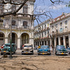 Typical Cuban street scene with classic american cars.