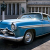 Blue Cuban car outside the Capitolio building at Old town Havana, Cuba. Car is a 'Desoto' model. Registration digitally altered to 'Cuba'.