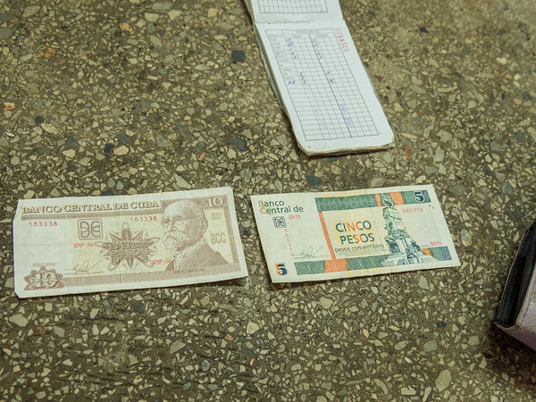 "There are two Cuban currencies, convertible peso (CUC) for tourists and ""diplomats"", and peso (CUP).  There are 25 CUPs per CUC. Havana, Cuba, June 2, 2016."