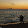 Silhouettes at sunset, Playa Ancon, Cuba
