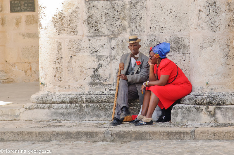 Couple waiting for customers in Plaza de la Catedral, La Habana Vieja (Old Havana), Cuba