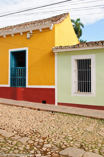 Coblestone street lined with pastel-colored colonial houses, Trinidad, Cuba