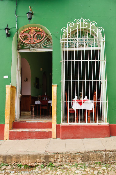 Typical house with  wrought-iron ornamental grills, now a restaurant, in Trinidad, Cuba
