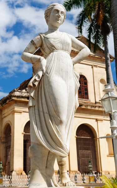 Statue in front of the Holy Trinity church in Plaza Mayor, Trinidad, Cuba