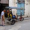 Servicing their bici-taxi.