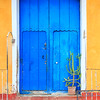 Cuban architecture - typical bright blue wooden door and walls in Caribbean colors, Trinidad, Cuba