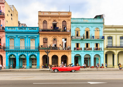 Havana street scene - historic buildings and classic cars on Paseo di Marti, La Habana Vieja, Cuba