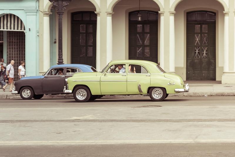 Lime green American classic car driving in Havana, Cuba