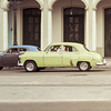 Lime green American classic car driving in Havana, Cuba