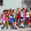 A group of Cuban Kids laughing at the street.