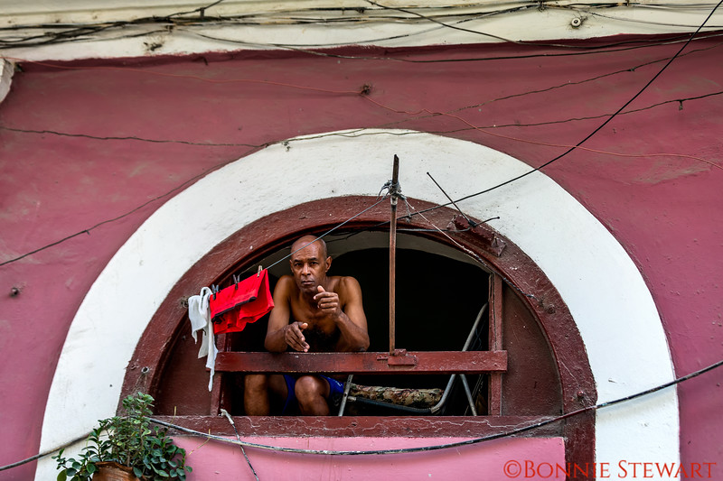 A Cuban from Havana looking out from his home
