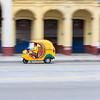 Cocotaxi auto rickshaw driving on Paseo del Prado, Havana Cuba