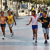 Boys and Girls are racing on the Paseo de Martí, Havana