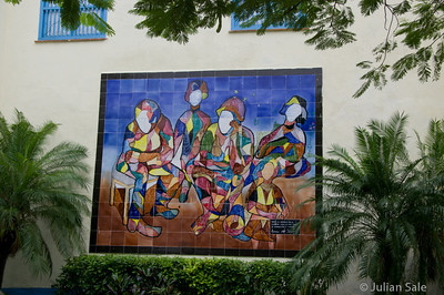 A colourful mural in one of the few squares which has been repaired and modernized.