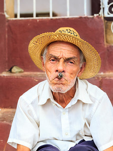 Portrait of old man smoking cigar in colonial Trinidad, Cuba