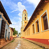 Cobbled street and bell tower of the Iglesia y Convento de San Francisco in Colonial Trinidad, Cuba