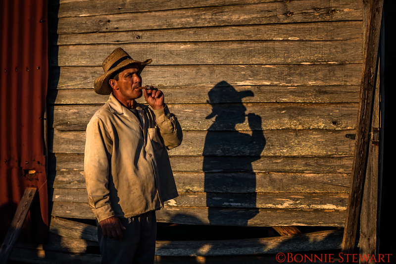 Ernesto and his shadow smoking a cigar