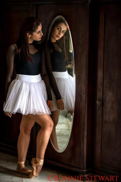 Ballerina looking in the mirror