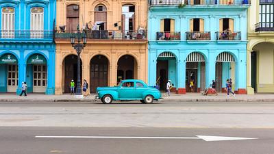 Havana street scene - historic buildings and classic cars on Paseo di Marti, La Habana Vieja, Cuba
