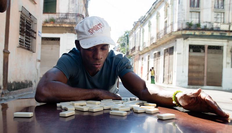 Raúl Lemos plays dominos on Calle Virtudes in central Havana on March 9, 2014.
