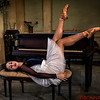 Ballerina posing with Piano