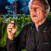 Jim Cline smoking a cigar in the tobacco barn