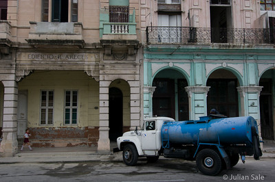 The pipes supplying water to many building have long since stopped functioning and are never fixed.  Thus, for many buildings, the only water supply is via trucks which pump the water to storage tanks on the roof.