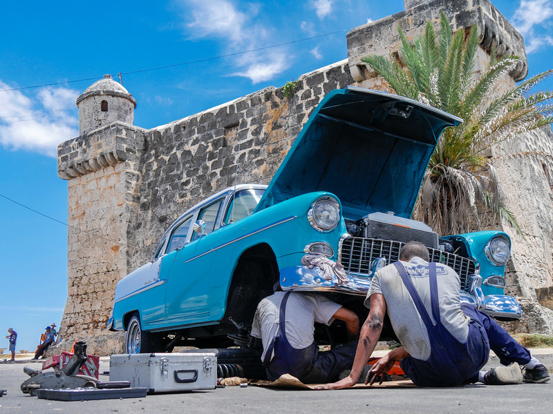 Car work in front of the Cojimar Fortress, Cojimar, Cuba, June 11, 2016.