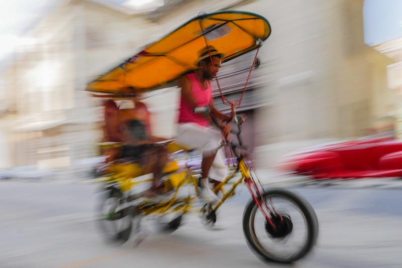 Bicitaxi in motion,  Havana, Cuba, June 11, 2016.