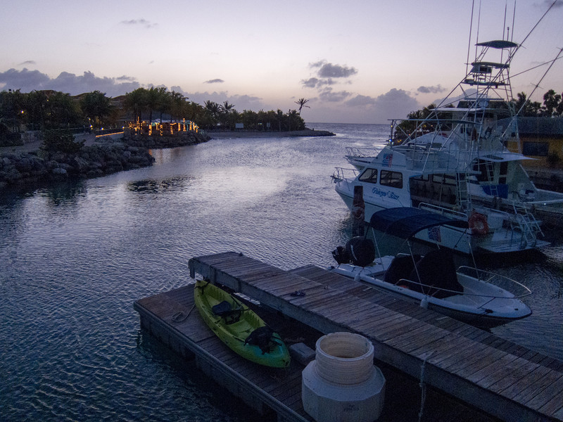 Augusto's Restaurant (illuminated at left), Lions Dive & Beach Resort Curaçao (right) at Dusk - February 2013