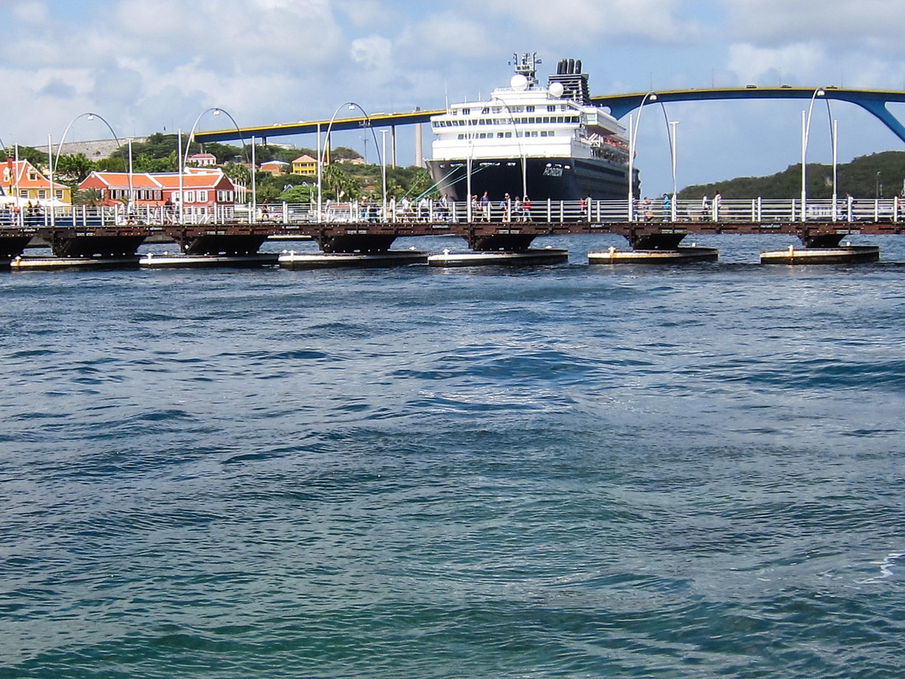 Queen Emma Pontoon Bridge (foreground) with Queen Juliana Bridge (background) in Willemstad, Curaçao - February 2013