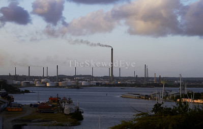 The Oil Refinery. Just over the hill from the previous shot, is this.  All the big ships that pass by the tourons (yes, me included) sipping fruity drinks under umbrellas at the Iguana Cafe in Punda wind up somewhere here in the refinery/scrapyard/cargo docks..