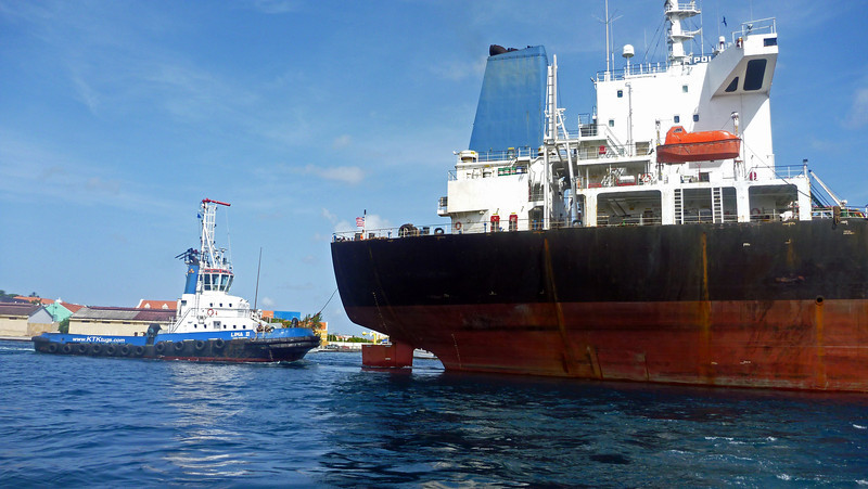 Tugboat assists freighter in St. Anna Bay Willemstad Curacao