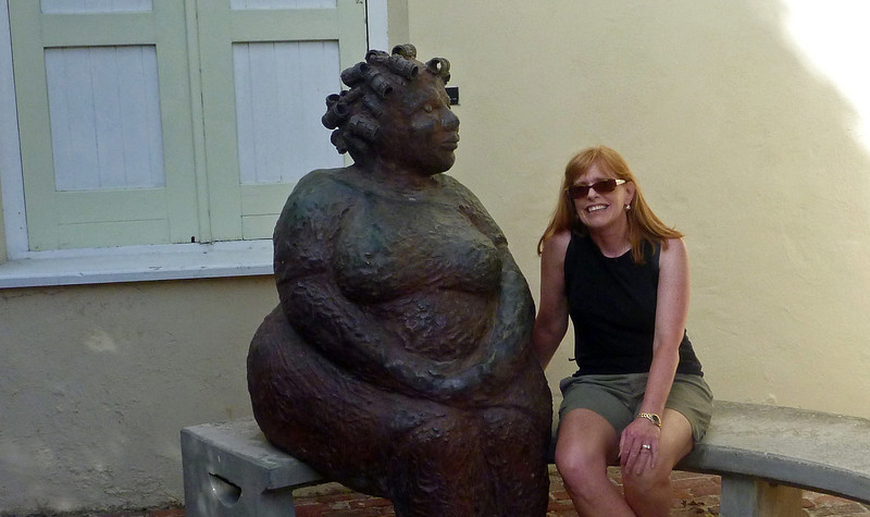 Nancy by statue at the Kura Hulanda Hotel in Willemstad Curacao
