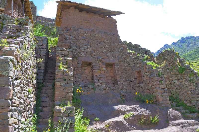 Some of the structures are stone walls at the bottom and adobe brick above   The remaining adobe is protected with a thatched roof.