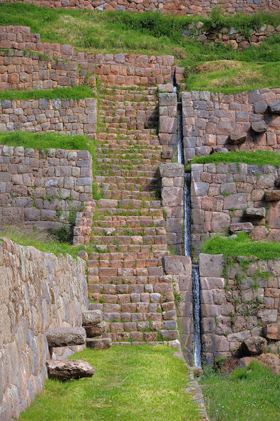 The water flows down along a series of stepped falls to each level.  The stonework in the aqueduct is as precise as the walls.