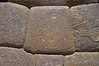 This stone mates to 6 other stones, each with a curved surface and with the entire wall leaning back.  There is no discernable gap at any surface contact.