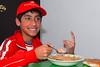 Sebastián Rojas Carrillo comiendo adobo en la casa de Sra. Rosalvina Santander, su abuela.