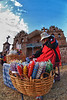 Vendedora de velas frente al templo Nuestra Señora de la Asunción - Tiobamba – Urubamba – Cusco - Perú<br /> <br /> Colourful candles sold at the entrance of Nuestra Señora de la Asunción - Tiobamba – Urubamba – Cusco - Peru<br /> <br /> Kleurrijke kaarsen worden verkocht aan de ingang van Nuestra Señora de la Asunción - Tiobamba – Urubamba – Cusco - Perú<br /> <br /> De bougies de toutes les couleurs sont vendues en face du temple Nuestra Señora de la Asunción - Tiobamba – Urubamba – Cusco - Pérou