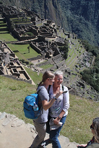 Laughing at their selfie at Machu Pichu.