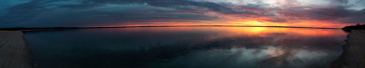 A panorama of Little Peconic Bay taken from the Nassau Point Causeway at dawn.  On the left is Indian Neck and on the right Nassau Point.  This is where I grew up in Cutchogue, NY.